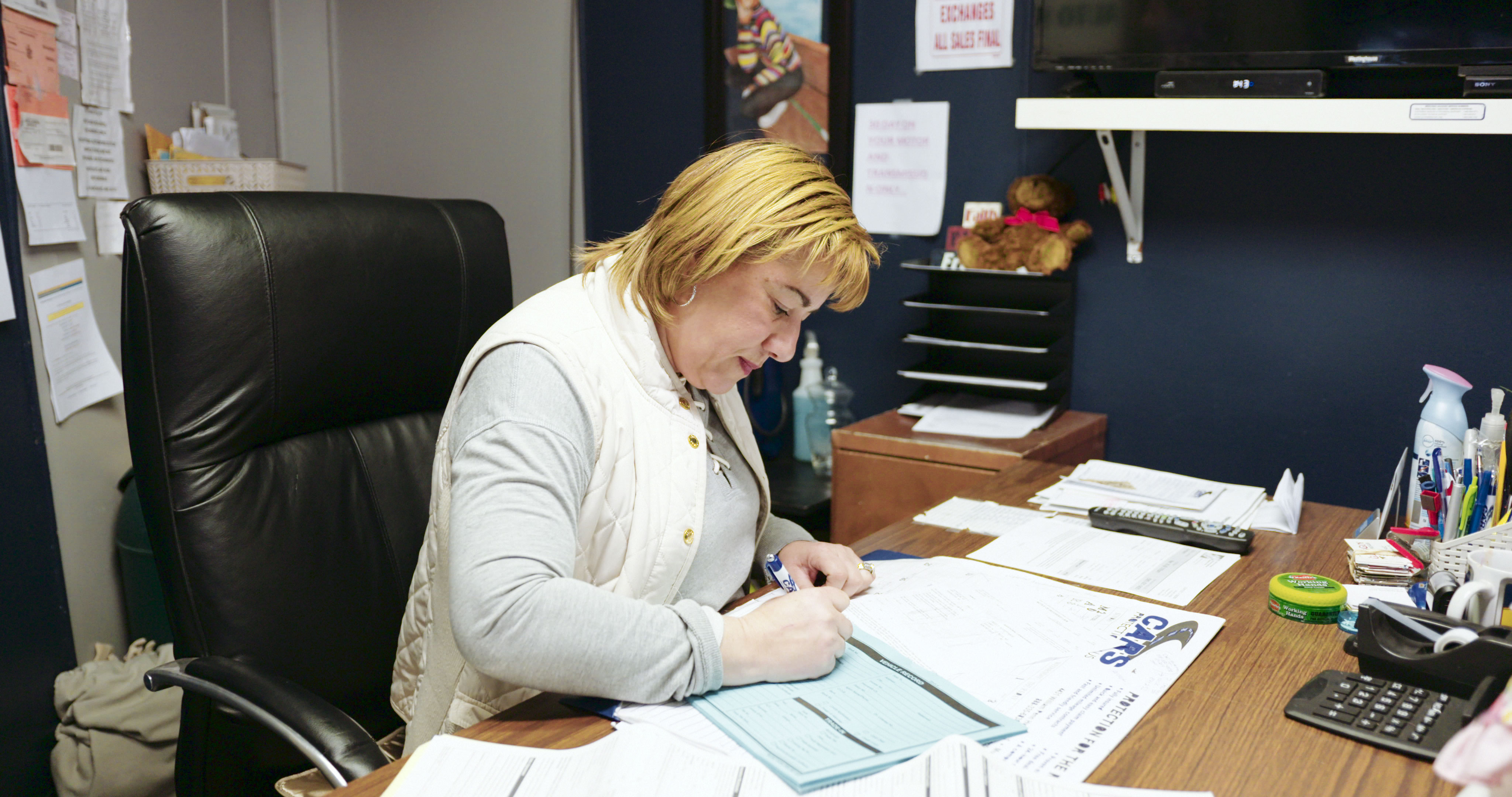 Woman working on paperwork at a desk